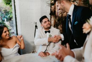groom shakes melbourne wedding celebrant hand